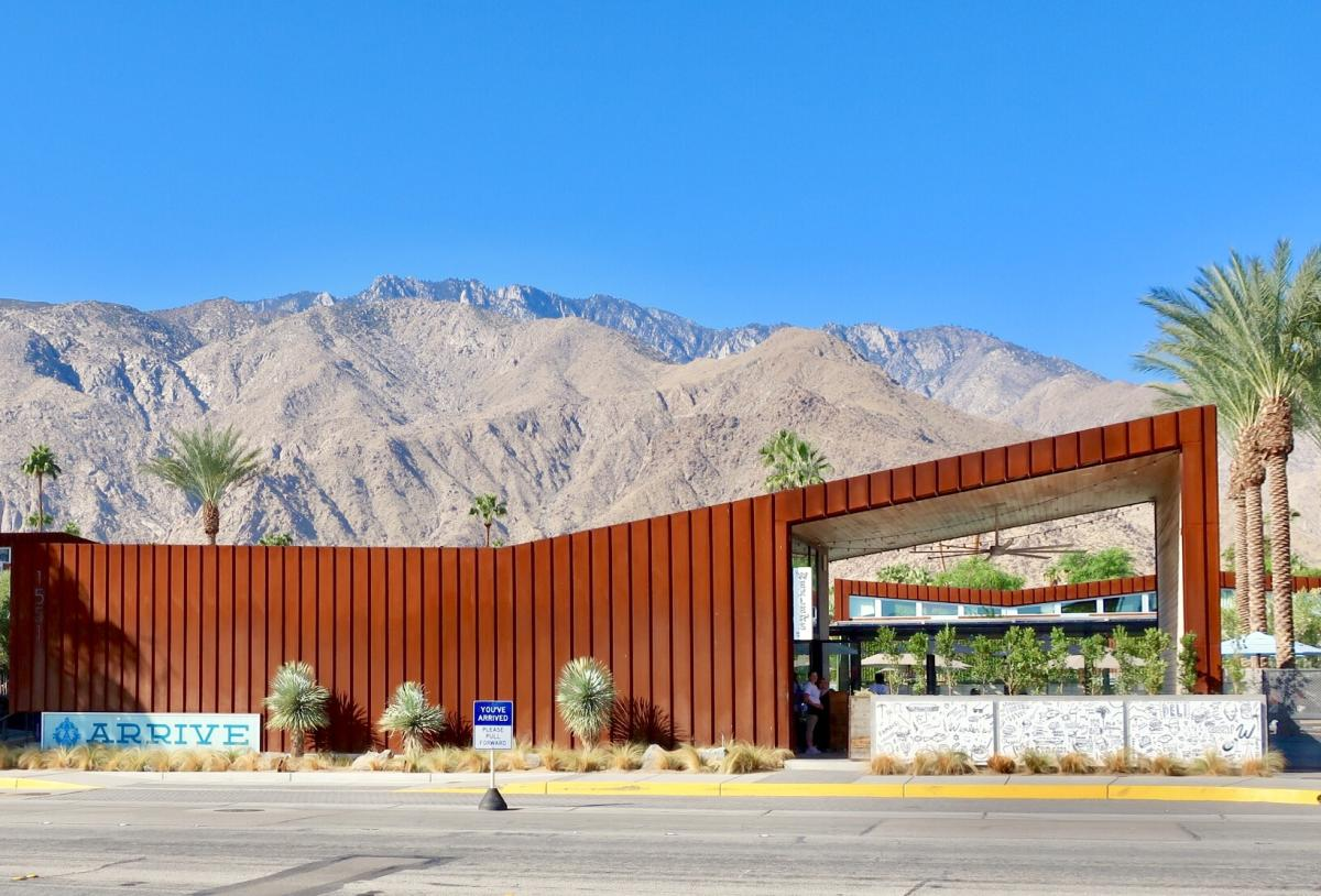 Sunny view of Arrive Hotel with the beautiful mountains in the background.