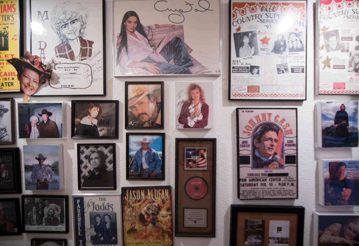 Upclose of Barbara Hubbard's hallway, and all of the gig posters of performers that she brought to New Mexico