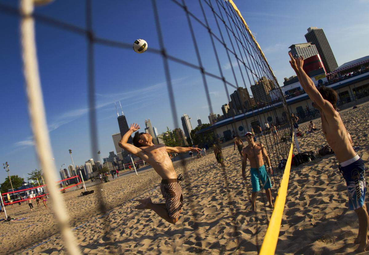 People playing beach volleyball in Chicago