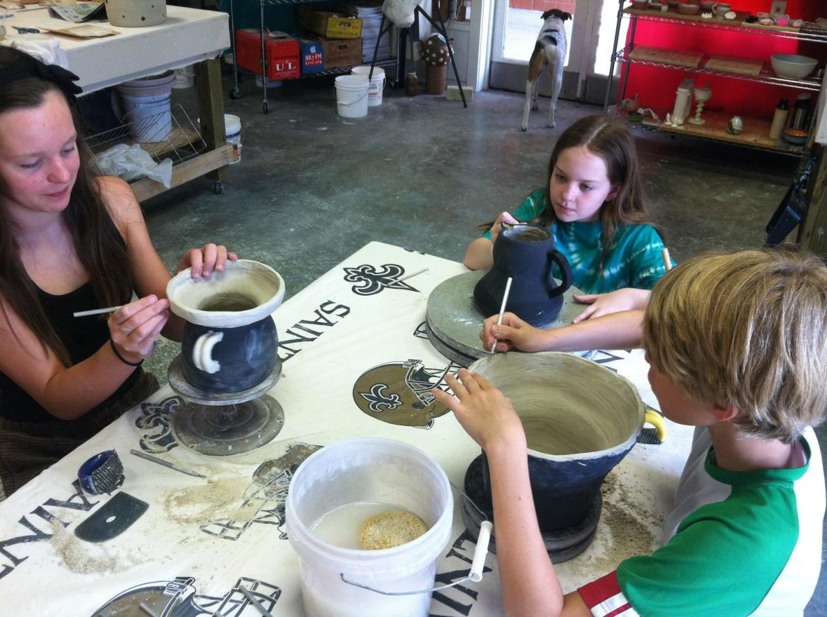 Artists decorate clay artwork at the Hand Star Clay Studio