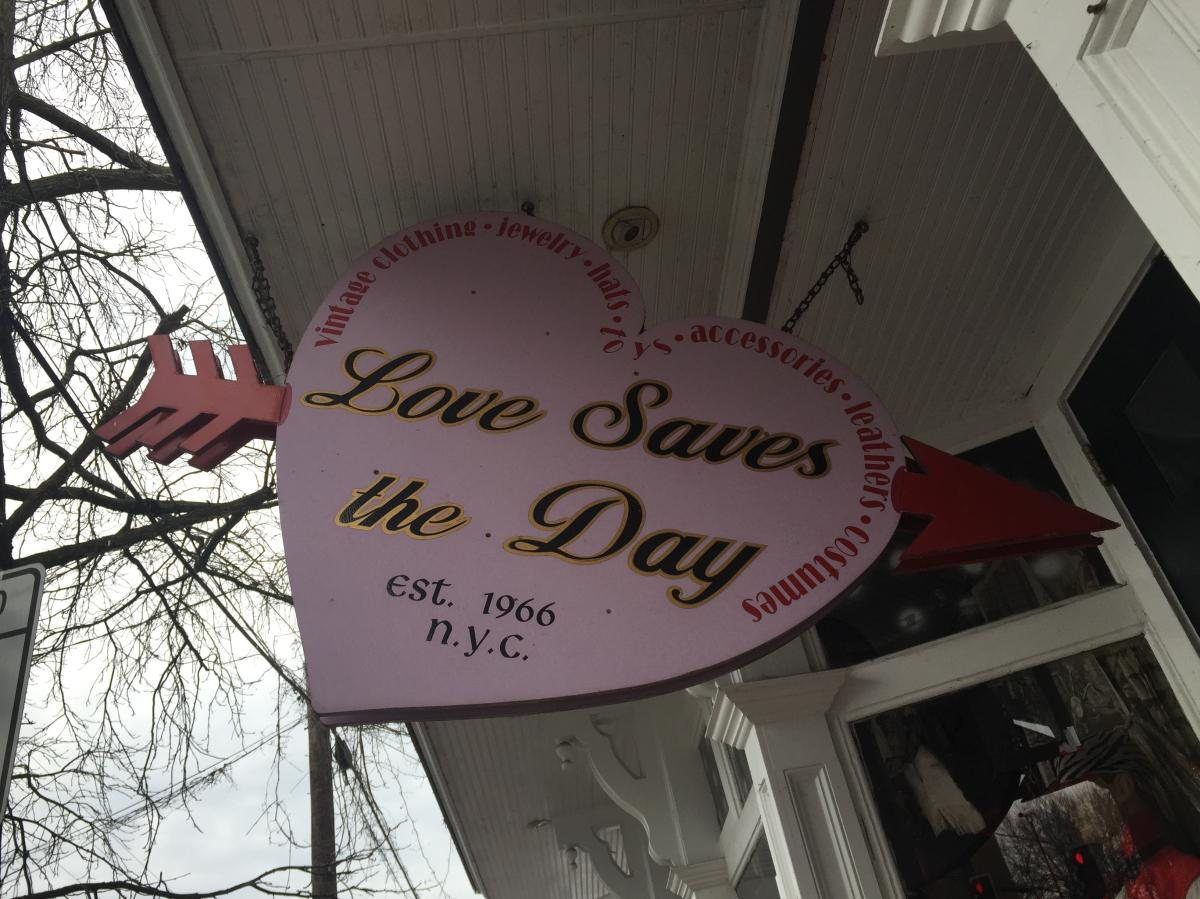 Love saves the day sign