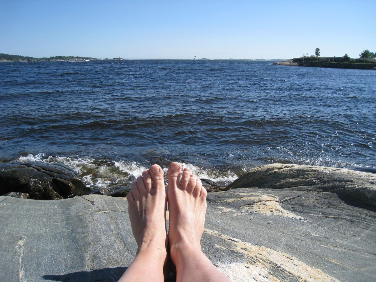 Toes and the sea in Bertesbukta in Kristiansand