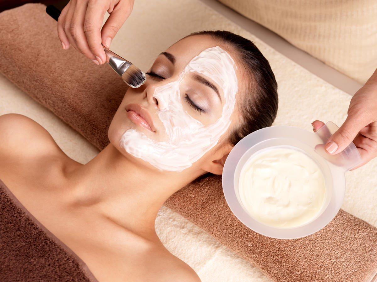 Woman relaxing with face mask on at spa
