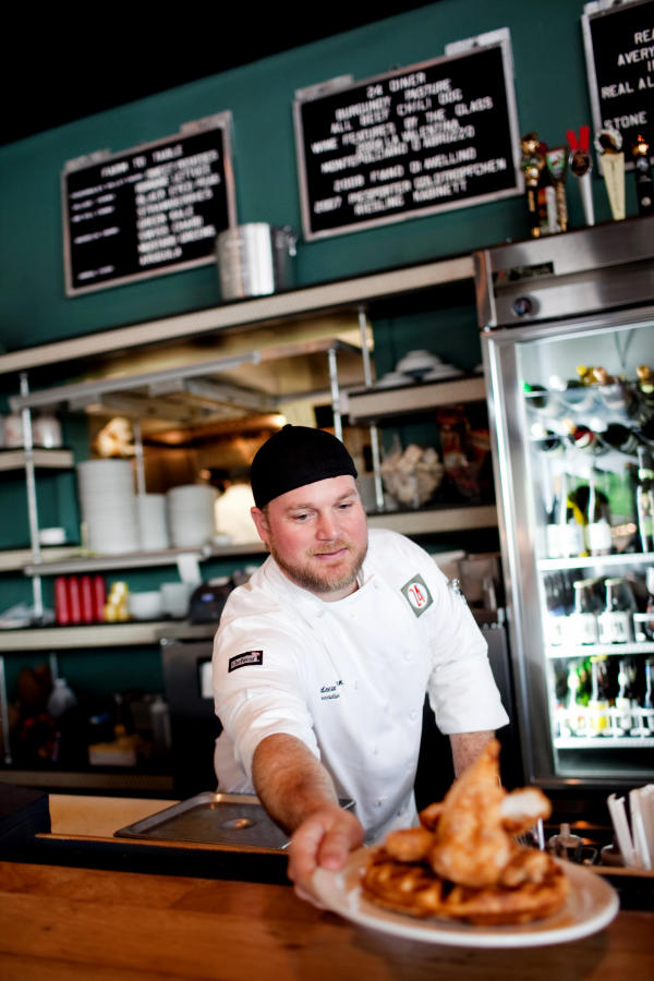 Chef Andrew Curren dishes out chicken and waffles at 24 Diner