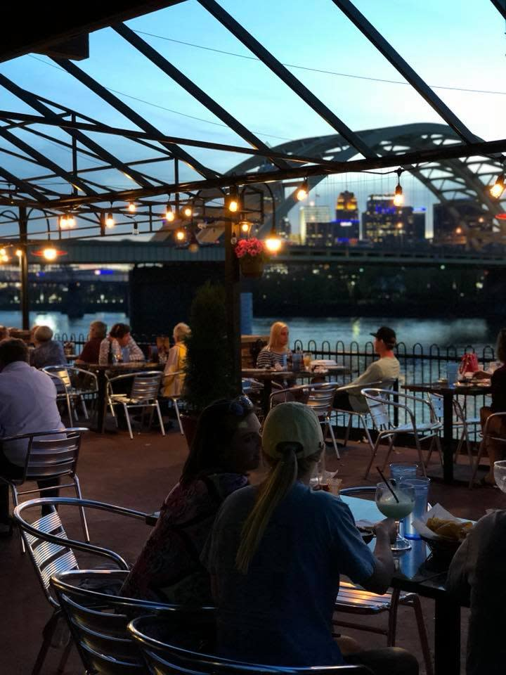Diners enjoying view of Cincinnati from Cancun Mexican restaurant