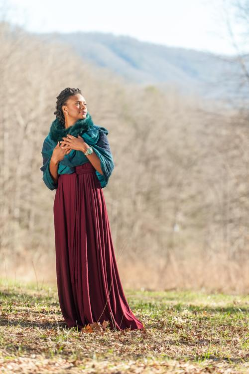 Lizz Wright stands in front of the mountains she calls home.