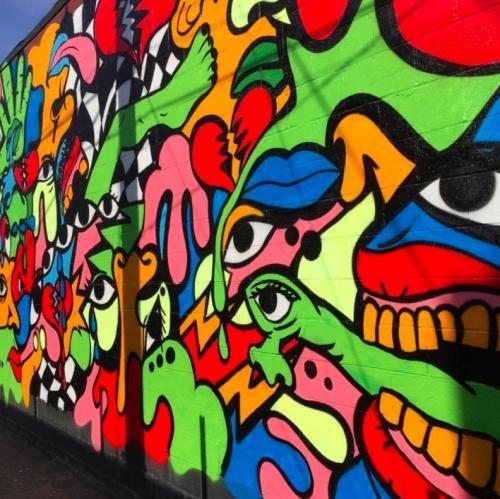 Street art mural by Detroit artist Sheefy McFly