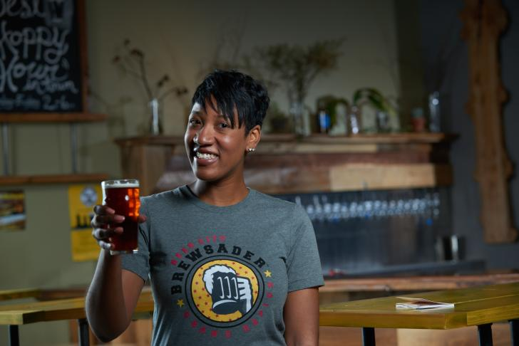 Woman wearing Brewsader t-shirt