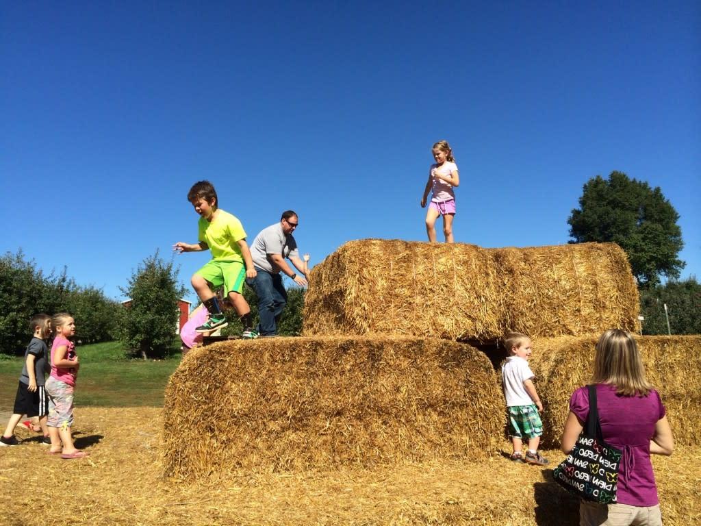 Kids playing on haystacks in Grand Rapids, Michigan