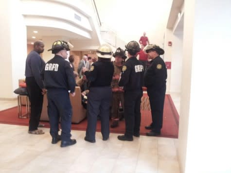 Grand Rapids Emergency Workers Discussing Flood at Marriott