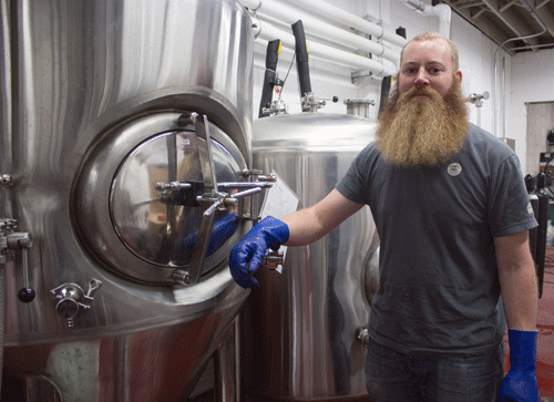 Brewer and co-owner Torrey Lattin standing in his brewery in Wichita, Kansas.