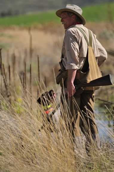 Wingshooting USA's Scott Linden standing in a field with his dog.