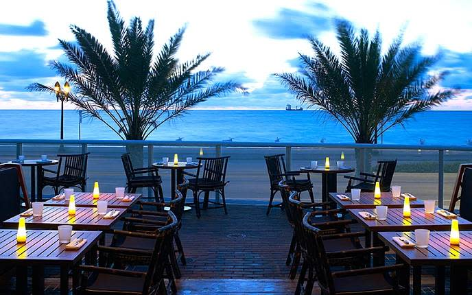 Patio dining area at Steak 954 with Fort Lauderdale ocean views