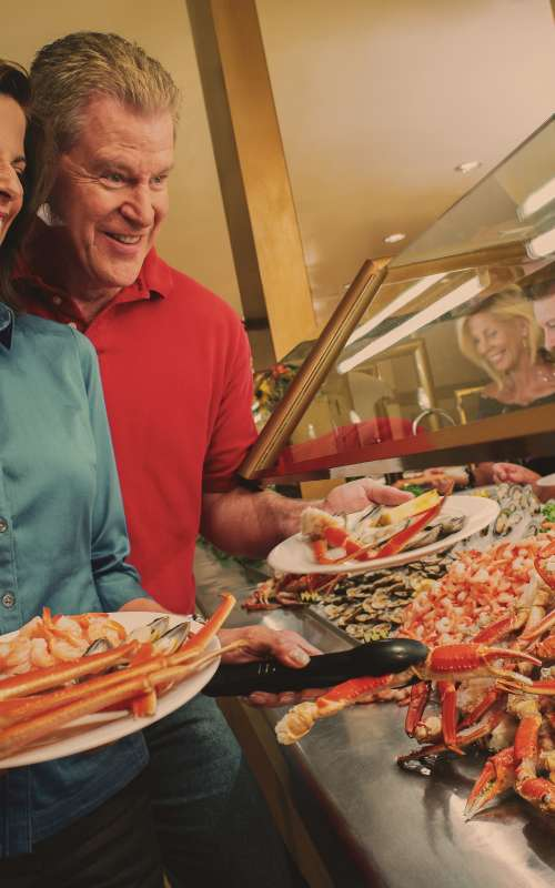 Photo of couple dishing up crab at buffet in Laughlin, Nevada