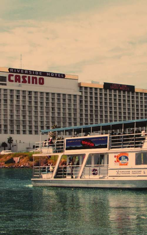 The USS Riverside floats past the Riverside Resort Hotel & Casino in Laughlin, NV