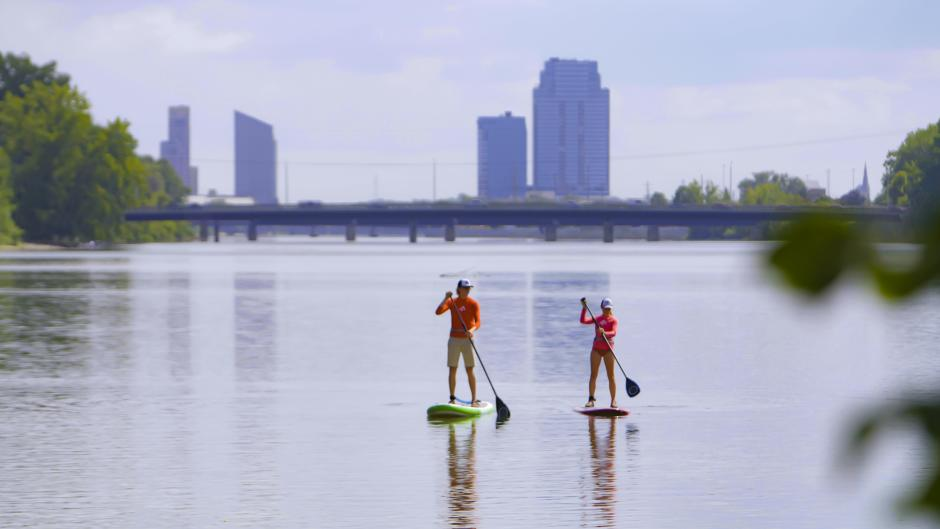 Stand up paddling towards downtown on the Grand River.