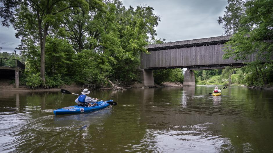 Jeff and Rita Newman, owners of GR Paddling, kayak down the Grand River.