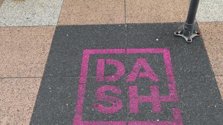 DASH marker on the sidewalk