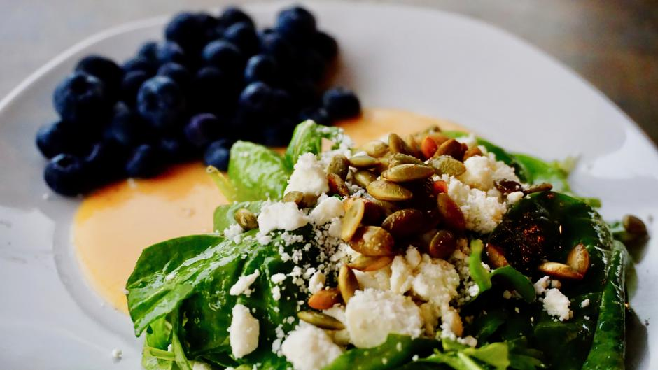 Don't miss out on Rush Creek's Blueberry-Peach Salad with baby spinach, arugula, blueberries, toasted pepitas, feta crumble, and roasted peach vinaigrette