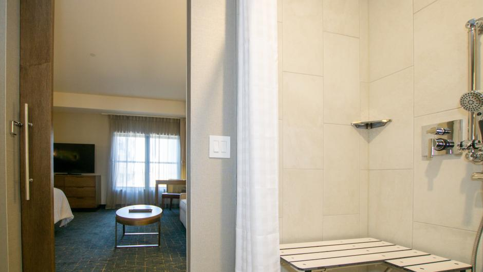 Accessible bathroom and hotel room at Embassy Suites hotel.