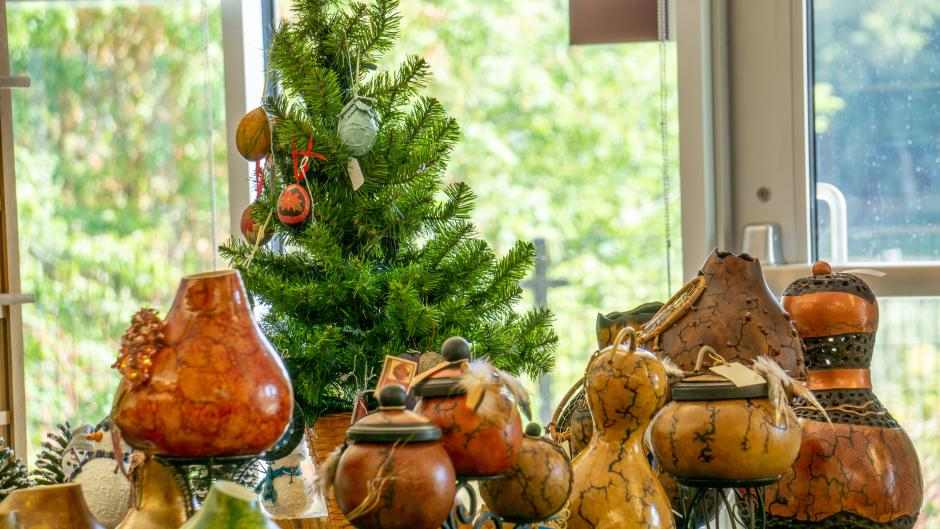 Painted and decorated gourds on a table at the Frederik Meijer Gardens gourd painting class.