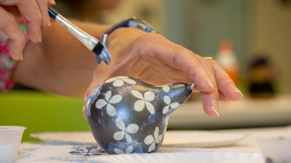 Silver-painted gourd with white flowers at Frederik Meijer Gardens' art class.