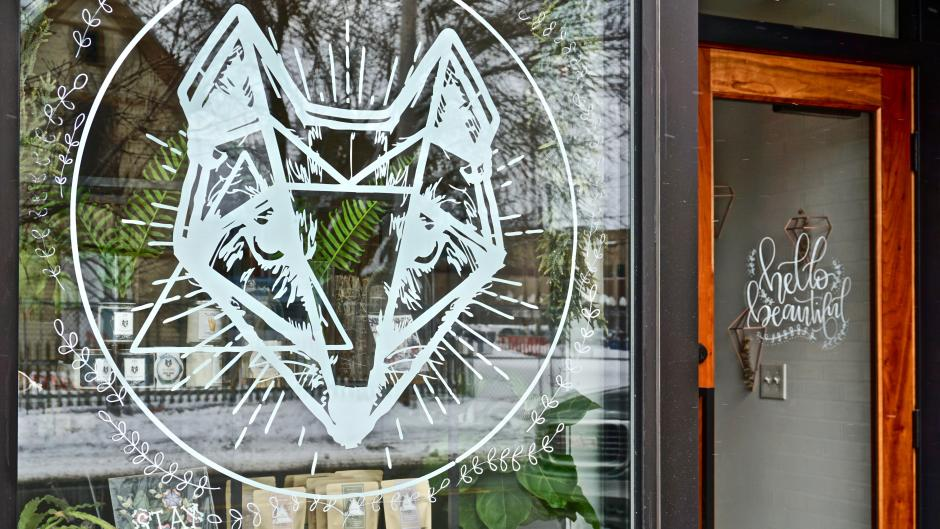 The front of Fox Naturals' shop in Grand Rapids, which has a large design of a fox in the window.
