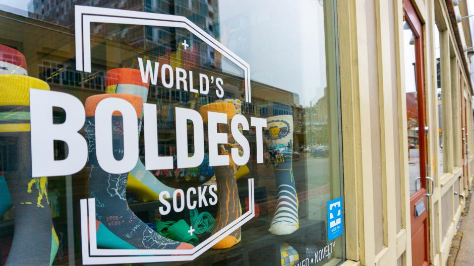 """Exterior window of boldSOCKS, which reads, """"World's Boldest Socks."""""""