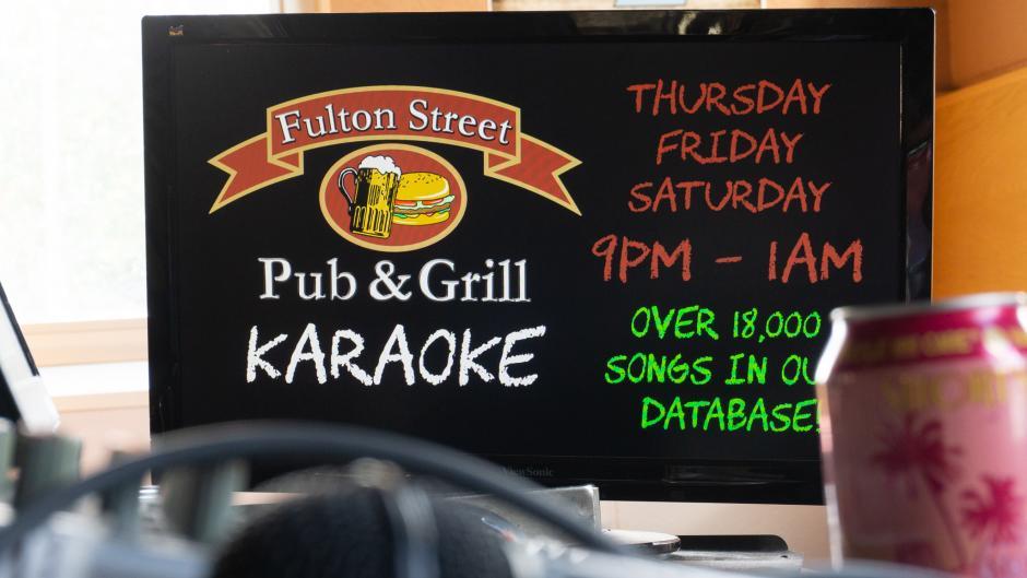A sign advertising Karaoke at Fulton Street Pub.