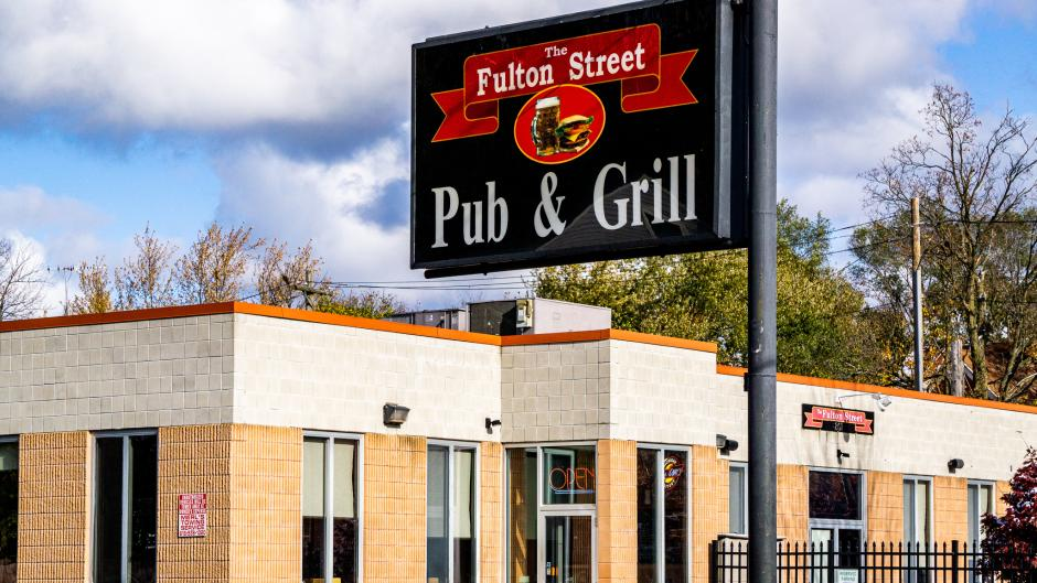 Exterior view of Fulton Street Pub & Grill sign and front entrance.