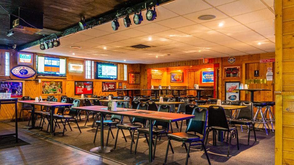 Log Cabin's dining area and stage for karaoke.