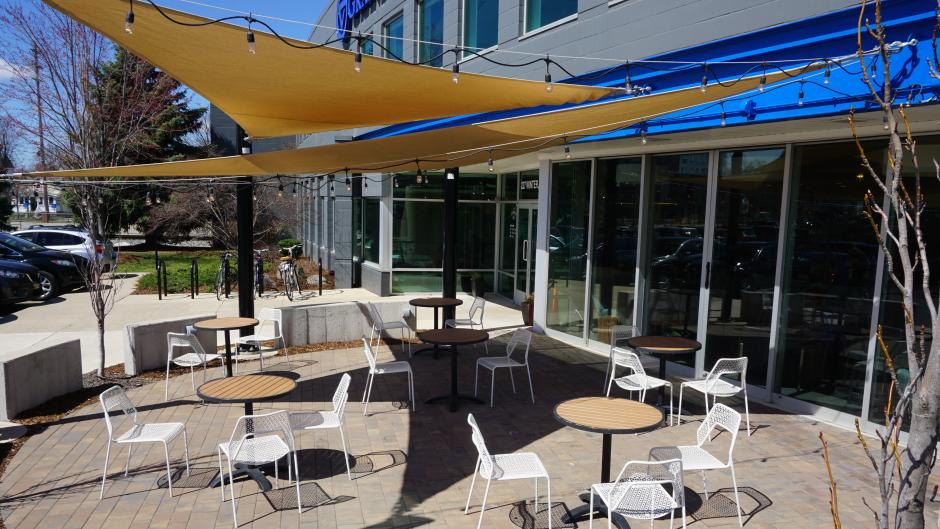 Enjoy your coffee drink under Ferris Coffee's outdoor canopies and string lights.