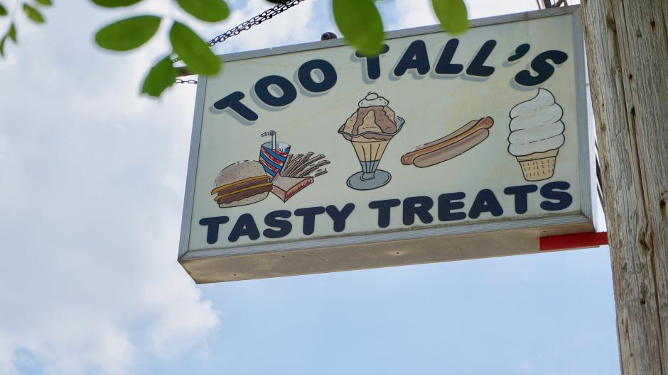 Too Tall's sign