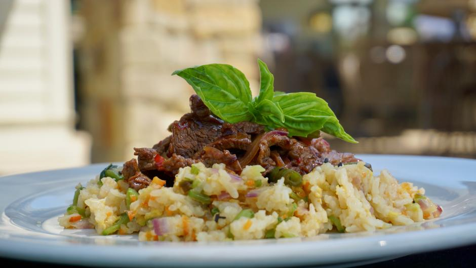 Visit FireRock Grille during RWGR to enjoy savory meat dishes like the Shaken Beef, which is a filet of beef, stir fried red onions, French beans, and basil with sweet chili sauce served over shrimp fried rice.