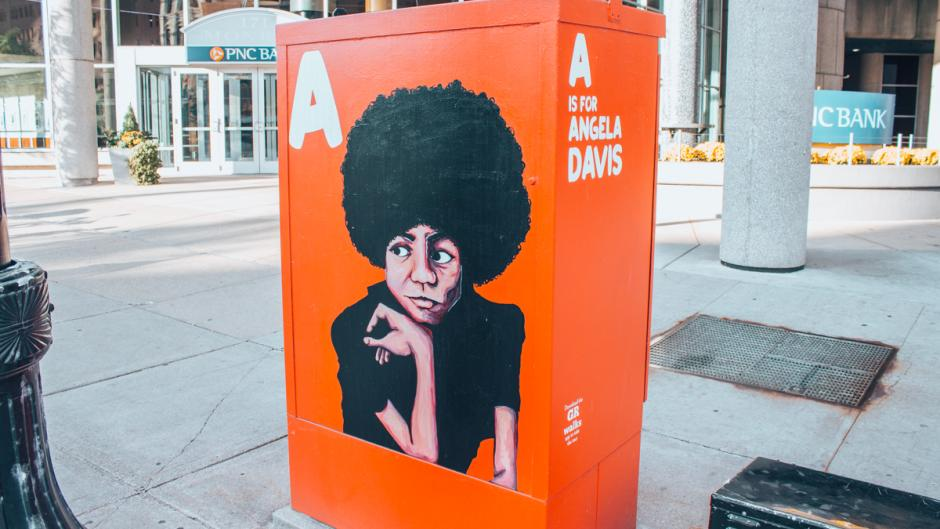Painting of a woman in downtown Grand Rapids.