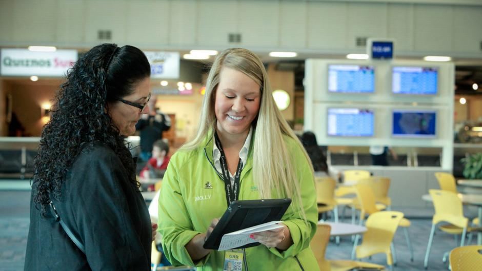 """Green coat"" staff are available to help Gerald R. Ford International Airport travelers navigate the growing airport and Grand Rapids community."