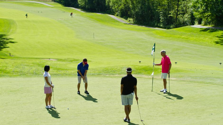 Four Golfers on the Putting Green