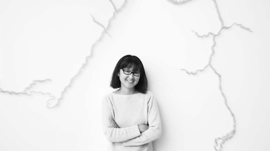 Maya Lin in front of her work, Pin River -- Grand River Watershed (detail).