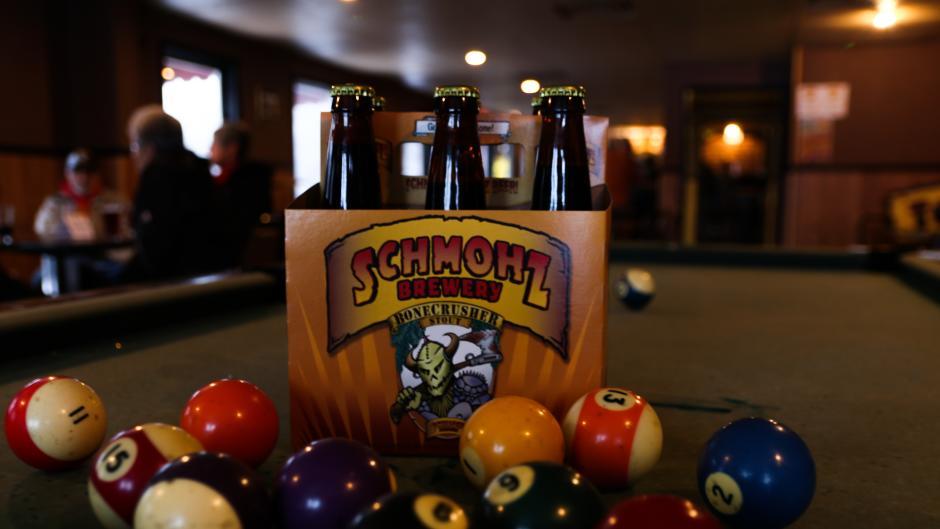 A game of pool pairs nicely with any of Schmohz's brews.