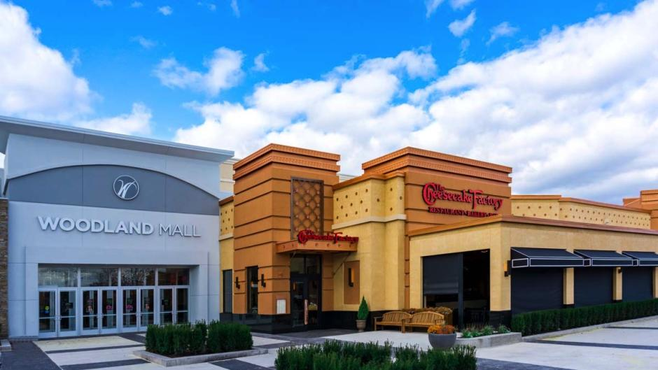 Exterior of the Woodland Mall entrance next to the new Cheesecake Factory.