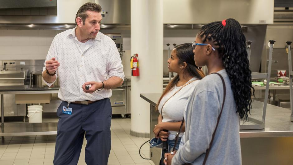Students talk with instructor during Discover Tourism Grand Rapids' tour.