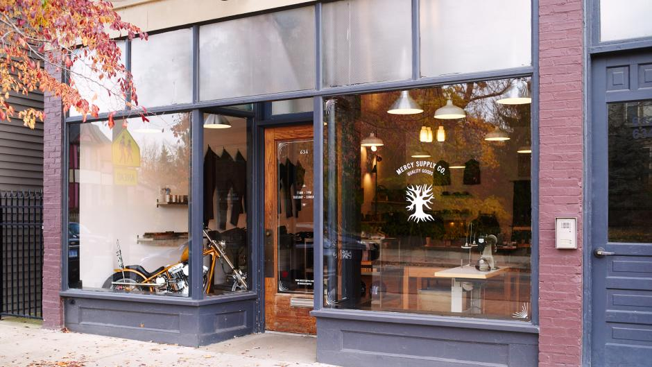 Suit up for your next cross-country bike tour at Mercy Supply Co. (motorcycle in the storefront not included).