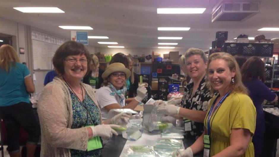 OrgPro 2014 attendees volunteering at Kids' Food Basket