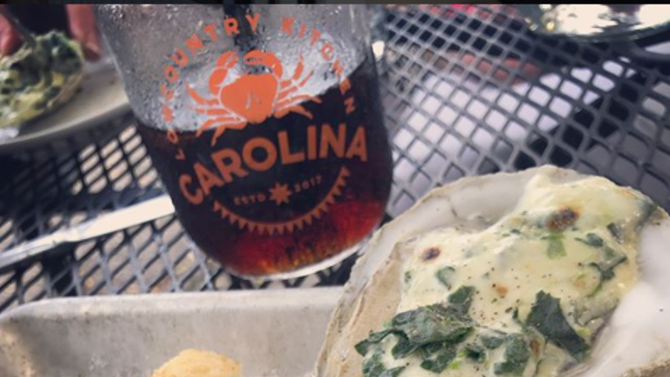 Carolina Lowcountry Kitchen's oysters Rockefeller feature grilled Blue Point oysters with cream, Penod liqueur, spinach and parmesan.