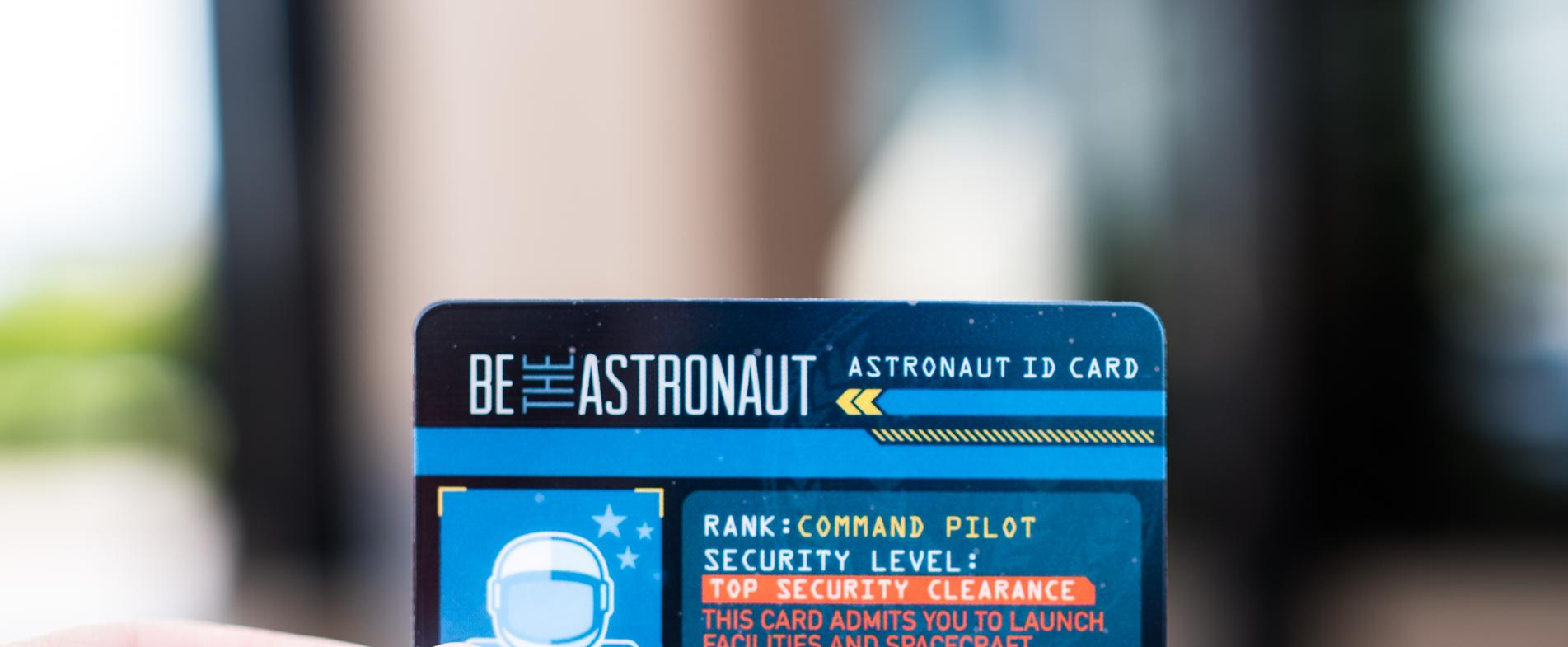 "Step into the Command Pilot role as you experience the Be the Astronaut exhibit with your ""astronaut ID card."""