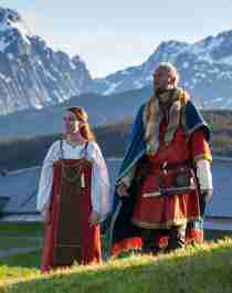Two Vikings in front of the Viking chieftains longhouse at Lofotr Viking Museum, Norway