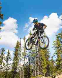 A person jumping with his mountain bike in Hafjell bike park, Eastern Norway