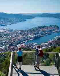 Hikers enjoying view from Mount Fløyen in Bergen, Fjord Norway