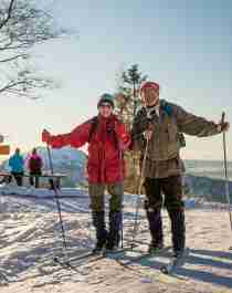 An elderly couple cross-country skiing at Mount Fløyen in Bergen, Fjord Norway