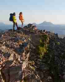 Two people hiking to Mount Rødøyløva in Helgeland, Northern Norway